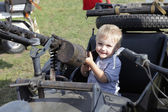 Child in sidecar with gun — Stock Photo