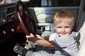 Happy child in car — Stock Photo