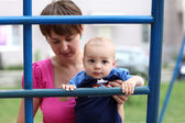 Baby on ladder — Stock Photo