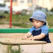Child playing in sandbox — Stock Photo #11873218