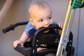 Child on push handle tricycle — Stock Photo