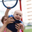 Child with gym ring — Stock Photo