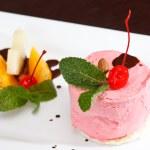 Cherry ice cream with fruits — Stock Photo