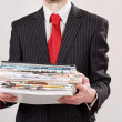 Stock Photo: Businessman with stack of paper