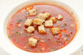 Plate of fresh gazpacho — Stock Photo