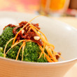 Stock Photo: Broccoli with carrot and dried tomato
