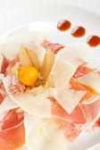 Spanish serrano ham with melon — Stock Photo