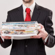 Businessman with stack of paper — Stock Photo