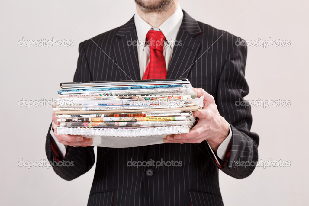 Businessman with stack of paper — Stock Photo #11642916