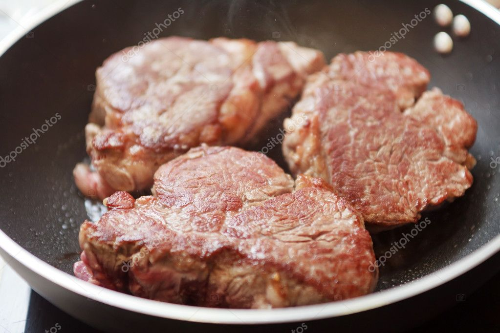 Beef steak in a frying pan — Stock Photo #11643553