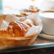 Croissant and a cup of coffee — Stock Photo