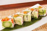 Tasty sushi with avocado — Stock Photo