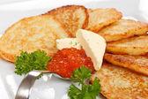 Fried potatoes pancakes with caviar — Stock Photo