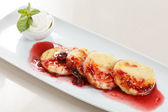 Cheese pancakes with cherry sauce — Stock Photo