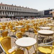 Rows of chairs and tables at the outdoor restaurant in Venice - Stock Photo