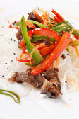 Meat with noodles and vegetables — Stock Photo