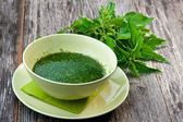 Stringing nettle soup — Stock Photo