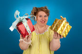Happy fat woman with a gift — Stock Photo