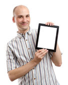Handsome smiling man with tablet computer — Stock Photo