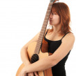 Redhead Girl with guitar on a white background — Stock Photo
