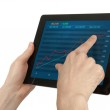 Hands holding digital tablet with stock Quotes — Stock Photo