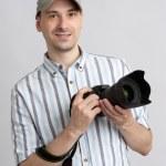 Man holding professional camera — Stock Photo #11665532