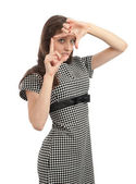 Young woman doing viewfinder gesture — Stock Photo