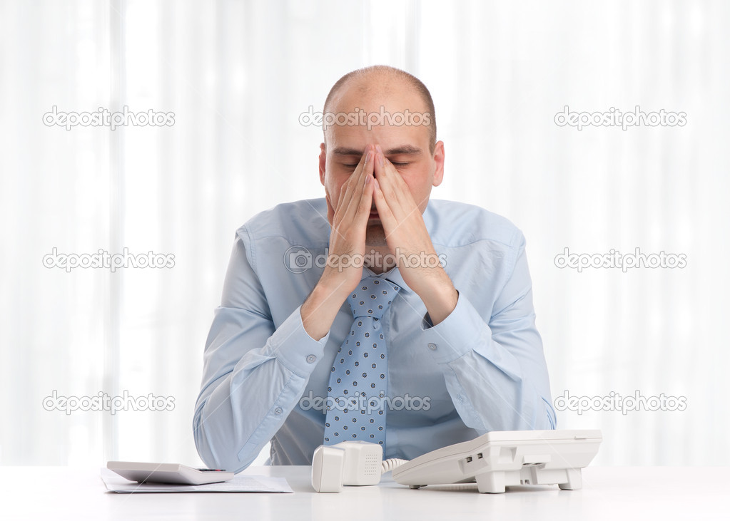 Tired businessman at work — Stock Photo #11893647