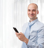Smiling business man with phone — Stock Photo
