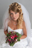 Beautiful blond bride studio portrait — Stock Photo