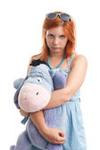 Young woman hugging big burro toy — Stock Photo