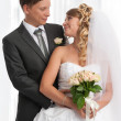 Happy bride and groom smiling - Stock Photo