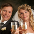 Happy bride and groom with champagne — Stock Photo