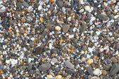 Mořské kameny jako pozadí — Stock fotografie
