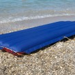 Blue inflatable raft on the sand sea beach — Stock Photo