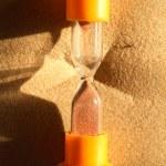 Hourglass On Sand — Stock Photo