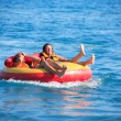 Friends Tubing On Sea — Stock Photo