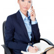 Business woman sitting on chair and using mobile phone - Stockfoto