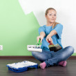 Smilling girl with paint tools — Stock Photo