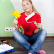 Woman paints interior wall of home — Stock Photo