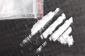 Cocaine powder in lines — Stock Photo