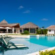 Caribbean resort with swimming pool - Stock Photo