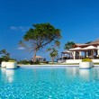 Resort with swimming pool - Stock Photo
