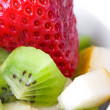 Fruit salad in white plate — Stock Photo