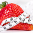 Strawberry with measure tape — Stock Photo