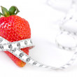 Strawberry with measure tape — Stock Photo #11975650