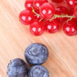 Berries on wooden board — Stock Photo