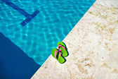 Slippers near swimming pool — Стоковое фото