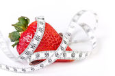 Strawberry with measuring tape — Stock Photo