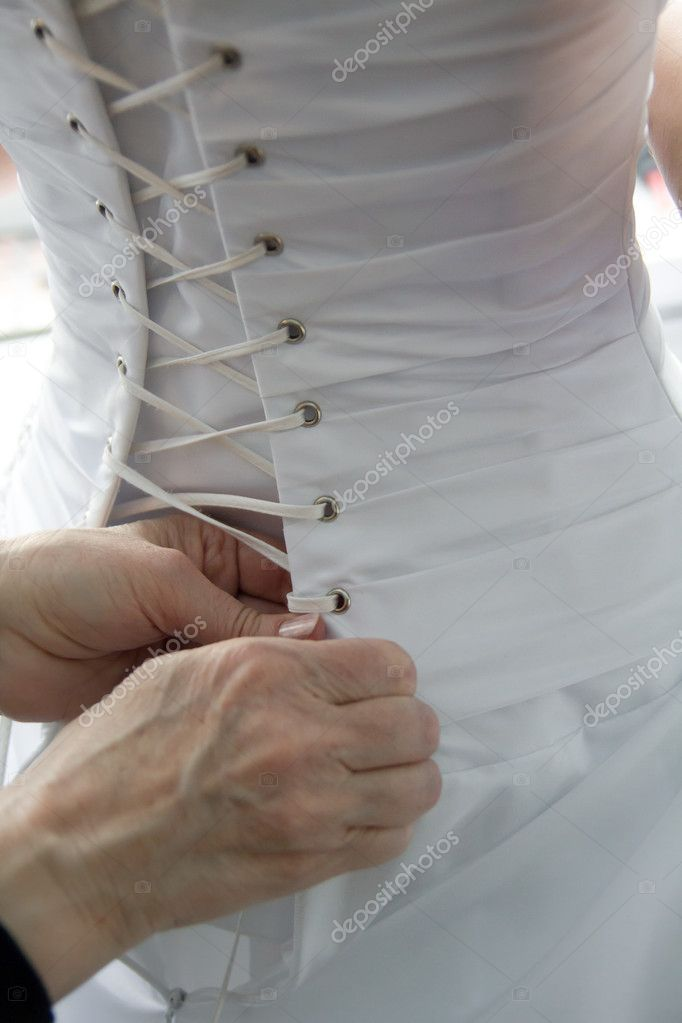 Helping with bride's corset, wedding white dress — Stock Photo #11975785